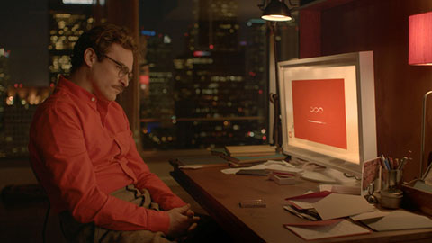 Theodore Twombly sits at his monitor, in a future where there are no devices, only the digital cloud. Image courtesy of Warner Bros. Entertainment.